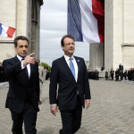 Outgoing French President Sarkozy and newly-elected president  Hollande attend a ceremony at the Tomb of the Unknown Soldier at the Arc de Triomphe to mark the end of World War II in Paris
