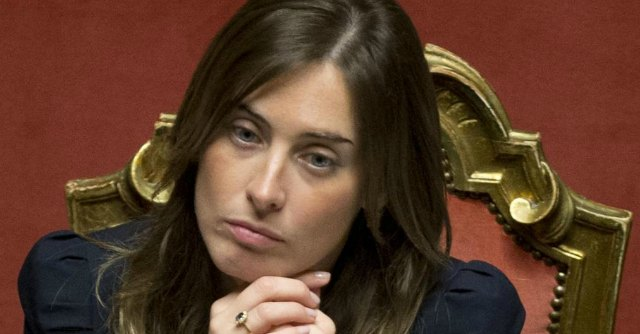 Relations with the Parliament Minister Maria Elena Boschi listens as Premier Matteo Renzi delivers his speech prior to a confidence vote, at the Senate, in Rome, Monday, Feb. 24, 2014. Renzi, Italy's youngest premier, is heading a new government he says promises will swiftly tackle old problems.(AP Photo/Andrew Medichini)